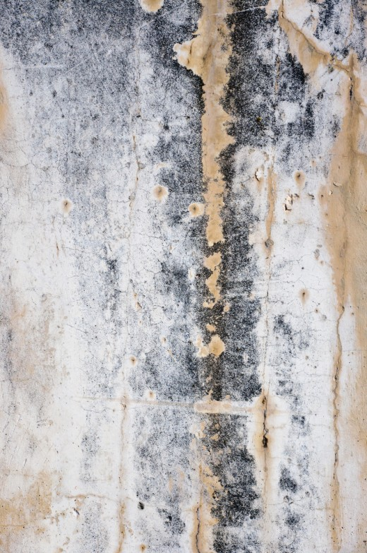 Dripping water stains on smoked wall