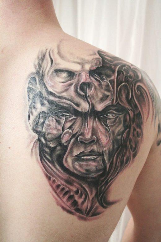 Face Skull Biomechanic Tattoo